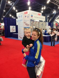 A and me at the expo... mother of the year who doesn't put shoes on her child in January in Texas :)