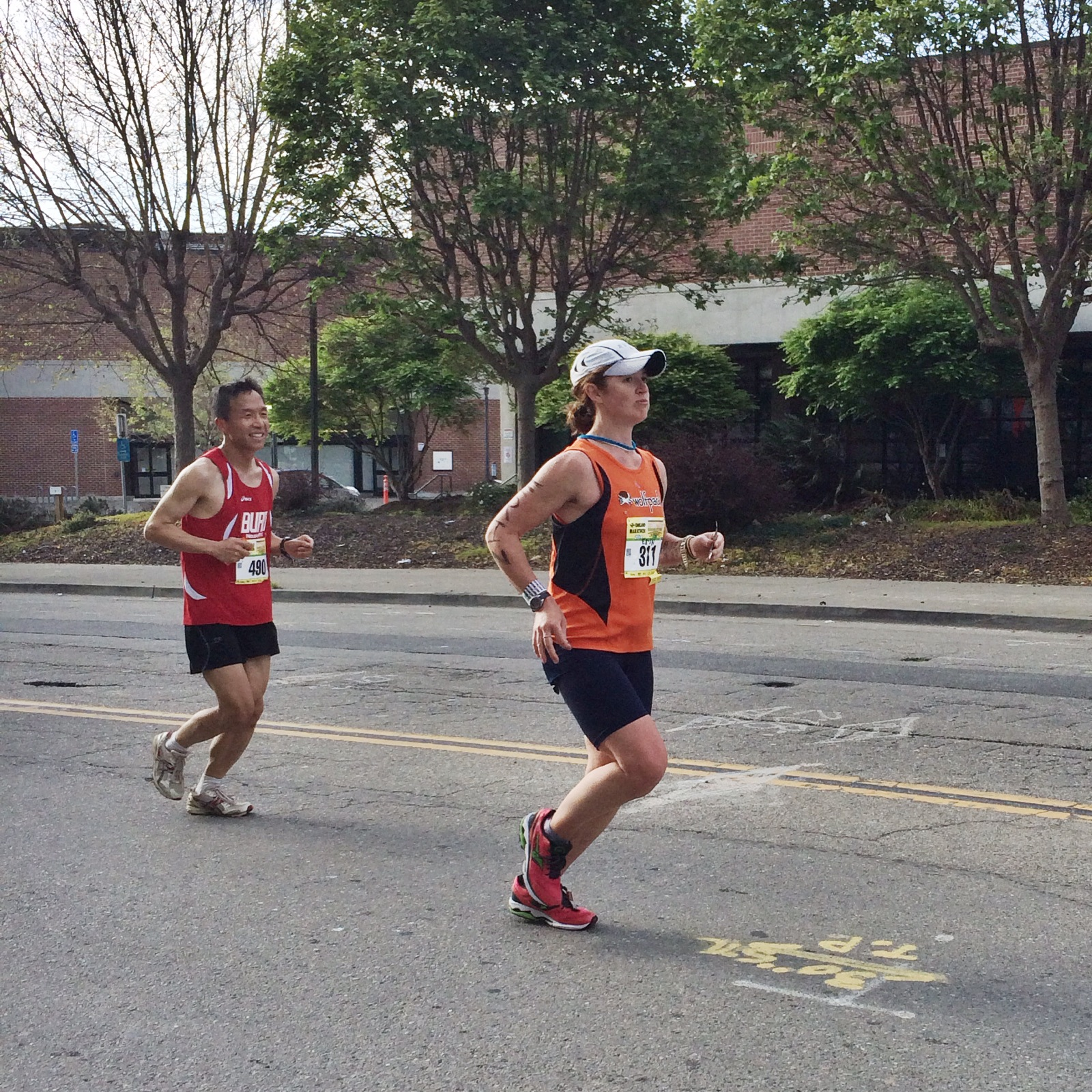 mid-run duck face; also, what I look like while eating oranges at mile 17+ of a marathon