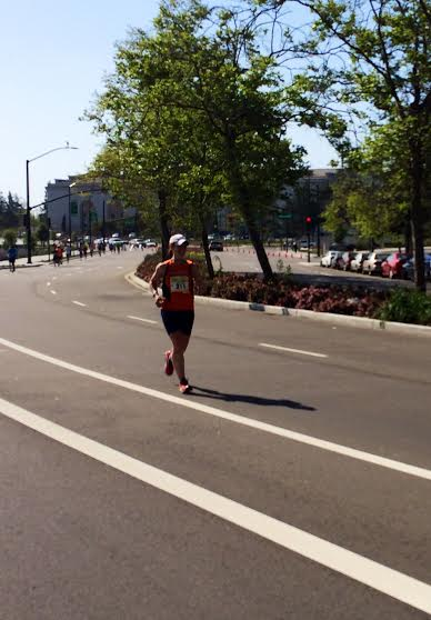 Oakland, circa mile 25. I've already failed on my time goal by now, so the new goal was to make sure that no one knew that I was even remotely disappointed. (source: Stone)