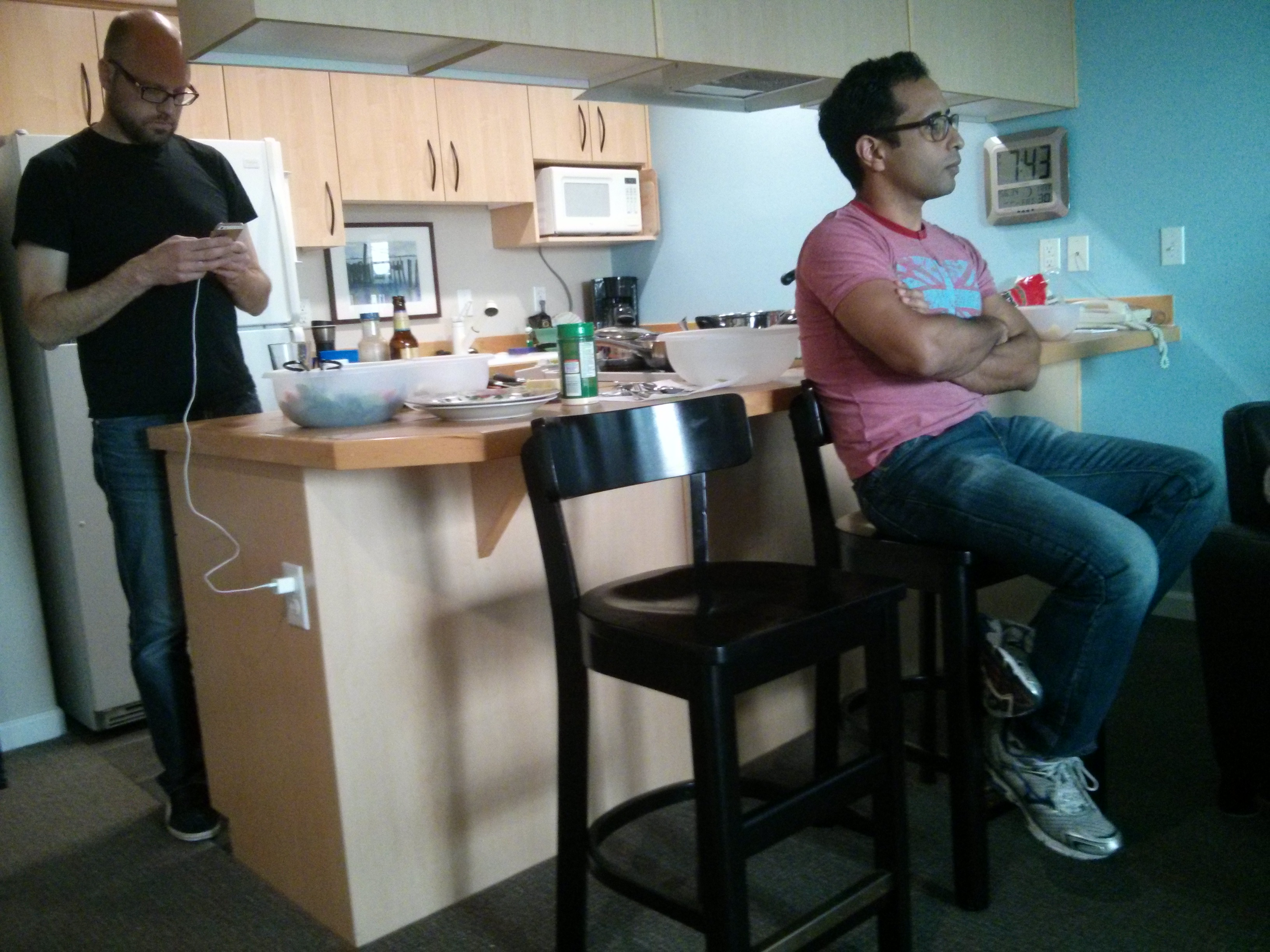 X taking a break from cooking to work while Richard (red) looks on