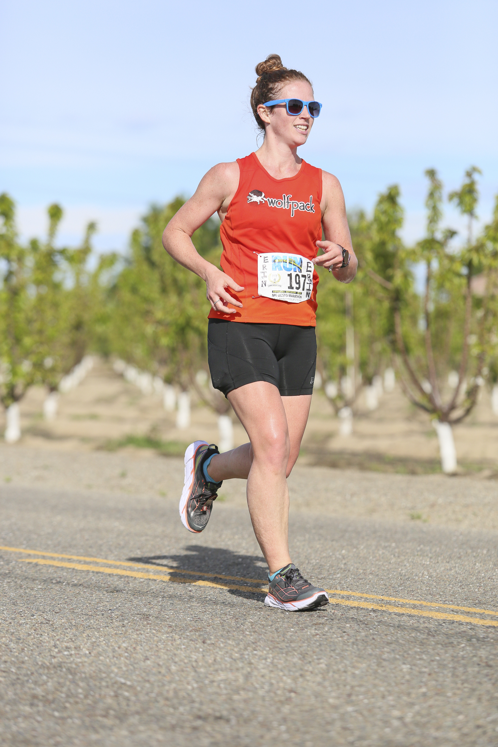 the race caught 15 different images of me, and I have a shit-eating grin in virtually all of them. It's pretty awesome. Note the red face here; it was getting hot. (also: almond trees in the background, perhaps)