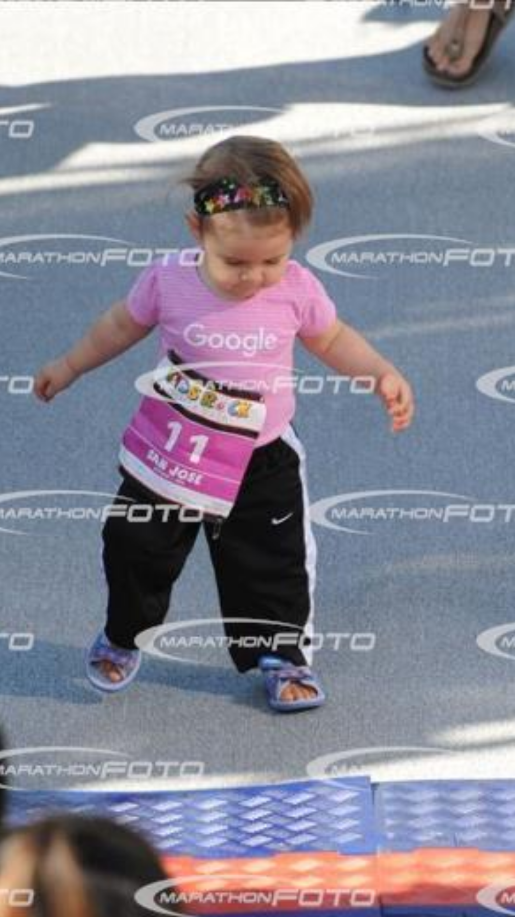 "I think she was the only walker in her ""diaper dash"" heat :) (and yes, marathonfoto thinks you'll pay for pics of your kid walking about 5 feet...)"