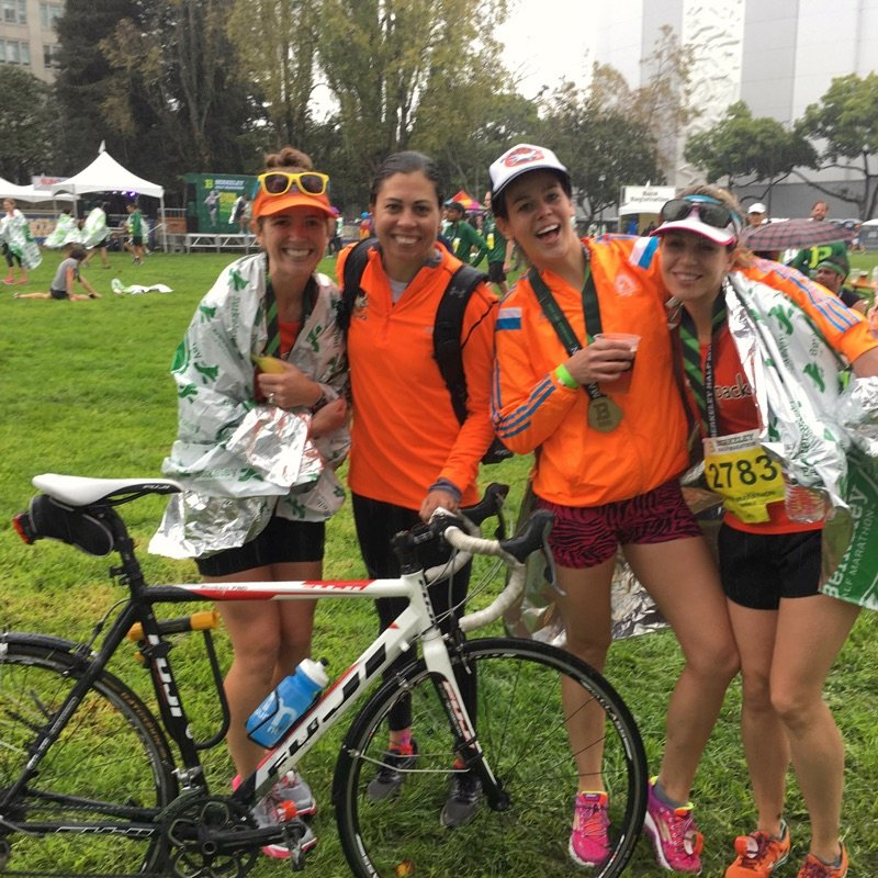 shivering in the rain with Coach Lisa, KB, and Meg. I ran back to Meredith's wearing that mylar blanket tied around my waist. (PC: Meredith)